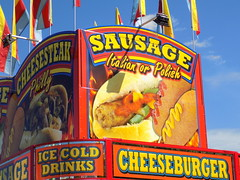 Sausage/Cheeseburger Trailer. (dccradio) Tags: nc northcarolina cumberlandcounty fair cumberlandcountyfair countyfair festival communityevent fun entertainment nikon coolpix l340 bridgecamera bigrockamusements amusement carnival midway attraction outside outdoors fairrides amusements amusementrides fayetteville foodconcessions foodtrailer concessionsstand fairfood food eat snack meal sausage italiansausage polishsausage cheeseburger drinks corndogs cheesesteak phillycheesesteak flag flags mustard ketchup catsup supper dinner lunch