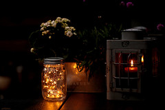 Fill your nights with magic... (eleni m) Tags: outdoor garden dark tabletop table light lantern magic candle lights darkness dof night plants flowers flowerpot jar glass lid reflection