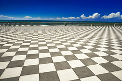 Terrazza di Livorno (petrapetruta) Tags: seawall pavement view italy mediterranean blue walk outside chess