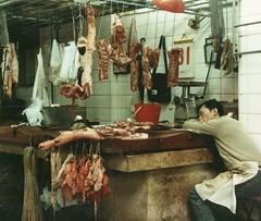 A DANGEROUS NAP (NC Cigany) Tags: butcher hongkongisland food hongkong street sleeping man meat filthy asia memory