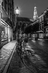 City Portrait (McQuaide Photography) Tags: haarlem noordholland northholland netherlands nederland holland dutch europe sony a7rii ilce7rm2 alpha mirrorless 1635mm sonyzeiss zeiss variotessar fullframe mcquaidephotography lightroom adobe photoshop tripod manfrotto stad city urban lowlight dusk twilight architecture outdoor outside illuminated street straat warmoesstraat wideangle wideanglelens groothoek building longexposure oldstreet old oud character traditional authentic streetlight emptystreet deserted empty nopeople cobblestone cobbles shadow light licht shop blackandwhite mono monochrome bw blackwhite window residential pedestrian nocars portrait grotekerk stbavo church bicycle bike fiets
