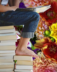 Bookworm (swong95765) Tags: lid girl reading books pile flowers cute flowery reader