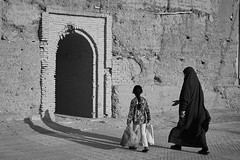 Morrocan veiled woman and little girl walking to fortification door, Taroudant, Morocco (Alex_Saurel) Tags: clothes fortress pleinformat forteresse fullframe fort sandales afrique planedusouss tarudant taroudannt fortification scans rempart edifice ⵜⴰⵔⵓⴷⴰⵏⵜ تارودانت‎‎ silhouette littlegirl sacamain running djellaba streetstyle petitefille walking streetphotography porte walk group ⵍⵎⵖⵔⵉⴱ position door people imeġrib maghreb northafrica voile streetscene detail ⵜⴰⵎⴰⵣⵗⴰ almaghrib travel noiretblanc blackandwhite maroc lifescene street veil hijab المغرب imagetype photospecs tamazɣa photoreportage archicategory stockcategories photojournalism scènedevie bag sony50mmf14sal50f14