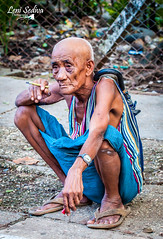 Burmese man waiting for his train (Leni Sediva) Tags: burma myanmar asia seasia canon czechoutmytravels people portrait oldpeople old smoking cigarette oldman man train yangon circle circletrain yangontrain backpacking travelling czechgirl lonelyplanet colours clothes wrinkles poverty poor rich