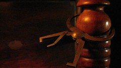 Calipering the Past (Rand Luv'n Life) Tags: odc our daily challenge antique tiger maple side chair leg turnings brass caliper measuring age rosewood sewing box soft diffused amber lighting macro wood indoor composition maxine kumin poem family reunion text