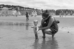 Wonderful and timeless moments- first step in the water with Mom. Trouville, côte fleurie, calvados, france (martine_vise) Tags: outside sealife sea beach beachlife summer summerlife portrait portraitphotography blackandwhite blackandwhitephotography normandie trouville france holidays baby babyphotography mom momphotography onthebeach alongthesea côtefleurie calvados parent goodmoments family funbeach babyandmom momlife