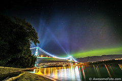 Northern Lights vs Bridge Lights (james c. (vancouver bc)) Tags: abstract arcs art astronomic astronomy astrophotography celestial exploring harmony idyllic landscape motion mountain nature night north reflect sea inlet water city lights rotation science serene serenity reflection sky space star starry tranquil tranquility tree universe canada landmark attraction seawall vancouver shoreline britishcolumbia stanleypark lionsgatebridge foreground aurora northernlights beach driftwood sand
