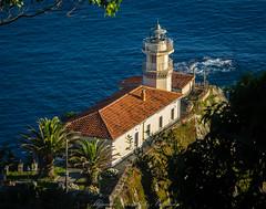 The Cudillero lighthouse (Alejandro Hernández Valbuena) Tags: lighthouse headlight light blue sea coast lamp lantern historic building cudillero spain