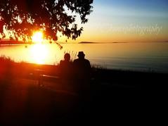 Qualicum Beach Sunset (Parksville Qualicum Beach) Tags: sunset couple bench ocean beach qualicum qualicumbeach vancouverisland bc canada