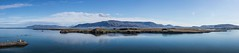 Reykjavik harbour (sussexscorpio) Tags: 2017 august cruise iceland reykjavik sea water pano panorama stitched mountains landscape lighthouse harbour quay reflections blue yellow clouds