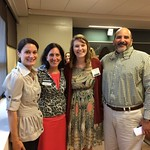 Student poses with professors at the Professional Networking Symposium