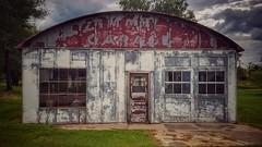 the retro garage... (BillsExplorations) Tags: abandoned rust old vintage garage building retro abandonedillinois forgotten closed shuttered illinois ruraldecay rural countryside weathered door window labelscar