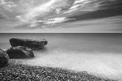 Cloudy beach (Rico the noob) Tags: dof landscape nature d500 outdoor stones sea published longexposure cyprus 1120mm ocean monochrome travel beach bw water sky blackandwhite 2017 clouds 1120mmf28