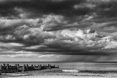 Showers out to Sea. (andybam1955) Tags: beach landscape monochrome squall coastal westrunton sky northnorfolk storm norfolk clouds