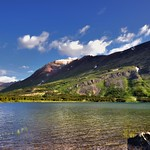 A Lakeside View to Mountains in Glacier National Park thumbnail