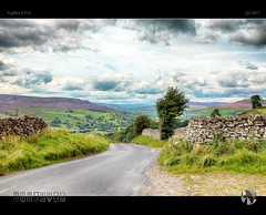 Over Dale and Down (tomraven) Tags: swaledale hills heather trees road stonewalls tomraven aravenimage home green summer sky clouds sun q32017 fujifilm xt10