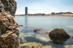Cesenatico (fil.nove) Tags: cesenatico romagna rivi rivieraromagnola nd1000 rocce rocks mare sea silkywater silkysea summer grattacielo skyscraper spiaggia beach