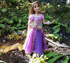 Snow White? Is that you? (ozthegreatandpowerful) Tags: disney store tangled rapunzel doll custom ooak reroot repaint accurate oneofakind dress pink purple heliotrope designer embroidery mother gothel pickingflowers hair rerooted design