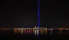 Infinite Light (chantsign) Tags: 911 memorial worldtradecenter newyorkcity bayonne skyscrapers tributelights panorama longview colors reflection water light colorsreflected sky black blue manhattan