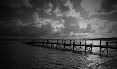 Embarcadero (alfonsocarlospalencia) Tags: embarcadero puntal cantabria santander nubes byn reflejos agua playa pedreñeras atraque bahía recuerdos verano luz crepúsculo geometría soledad silencio nostalgia ensueño belleza dionisio dionisíaco