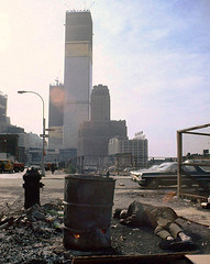 The early days of the World Trade Center in grubby old Manhattan. A homeless man sleeps next to a 50 gallon drum of burning scavenged wood. The World Telegram sign faces the Hudson. Old Radio Row blocks were now reduced to parking lots. New York 1970 (wavz13) Tags: oldphotographs oldphotos 1970sphotographs 1970sphotos oldphotography 1970sphotography vintagephotographs vintagephotos vintagephotography filmphotos filmphotography newyorkphotographs newyorkphotos oldnewyorkphotography oldnewyorkphotos vintagenewyork vintagemanhattan vintagenewyorkphotography vintagenewyorkphotographs vintagenewyorkphotos oldworldtradecenter vintageworldtradecenter twintowers originalworldtradecenter vintagetribeca oldtribeca lowerwestside vintageconstruction oldconstruction vintage35mm old35mm vintagekodacolor vintagecars vintagecar oldcar oldcars 1970scars collectiblecars collectablecars antiquecars manhattanskyline newyorkskyline newyorkskyscapers manhattanskyscapers 1970smanhattan 1970snewyork oldnewyork vintagesigns oldsigns antiquesigns newyorkphonecompany