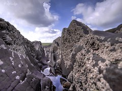 Canyon (Ian Gedge) Tags: uk britain wales pembrokeshire cymru rocks shells manorbier beach