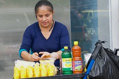 Manhattan (Union Square), NYC (backgroundgeo) Tags: manhattan nyc newyorkcity newyork unionsquare woman hispanic female street outside outdoors naturallight streetscene sonyalpha6500 sonyilce6500 sel55210 food colorful fruits faces stranger candid unposed person people captureone aperture working 14thstreet unlicensed selfemployed shoppingcart mangoes