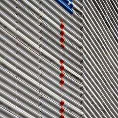 R'dam boogie-woogie (MyArtistSoul) Tags: rotterdam nl netherlands centraal station corrugated building siding red dash lines blue triangle stripes parallel simple minimal abstract urban square 8614