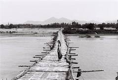 (grousespouse) Tags: vietnam 35mm film olympusom2n fzuiko50mmf18 50mm kodaktmax100 analog grousespouse croplab analogue portrait vietnamese river filmisnotdead
