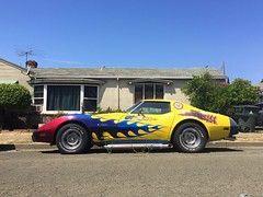 Heartbeat of America (misterbigidea) Tags: dailydriver 1976 coupe stingray customflames americana streetparking beauty neighborhood classic sportscar parked yellow corvette chevrolet chevy hotwheels