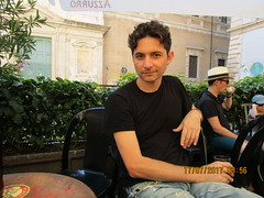 A local (RubyGoes) Tags: rome lazio trastevere italy calistobar tables chairs plants pink black oleander hat boy man peroni