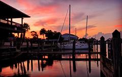 CARRABELLE MARINA SUNRISE (Wolf Creek Carl) Tags: sunrise red clouds sky docks marina sailboats outdoors florida water river carrabelleriver waterfront pier