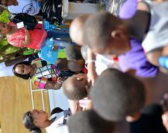 SCORES OF CHILDREN RECEIVE BACK-TO-SCHOOL SUPPLIES