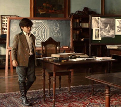 In Lessons (theirhistory) Tags: boy kid child glasses table chairs blackboardrug jacket shirt trousers boots room