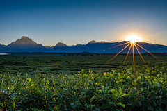 Sunset Behind Tetons (jpetcoff) Tags: grand national park wyoming sun sunset mountains plains hills sunburst summer warm hot day dusk evening nature landscape usa west tetons teton