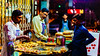 Flipping Burgers (Mansoor Bashir) Tags: islamabad pakistan burger food street color bokeh night urban canon 6d 50mm streetlife silhouette shadows light dark