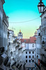 """is this Minas Tirith from Lord of the Rings? NO, looking down the steep Rua Nova Do Almada with the tops of  the Camara Municipal de Lisboa and the Arco da Rua Augusta visible above red tiled roofs, Lisbon, Portugal (grumpybaldprof) Tags: """"ruanovadoalmada"""" """"camaramunicipaldelisboa"""" """"arcodaruaaugusta"""" """"redtiledroofs"""" hill steep street views old colour summerevening summer evening lisbon lisboa portugal portuguese city colours lamps road hillside """"canonpowershotg1xmarkii"""" canon powershot g1xmkii """"125625mm"""" hdr"""