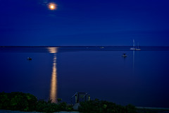 Moon at night over Provincetown Harbor (Brett of Binnshire) Tags: capecod usa powerboat sunset bay highdynamicrange moon sailboat hdr ocean bluehour lrhdr harbor water manipulations scenic lightroomhdr shoreline boat provincetown night locationrecorded massachusetts