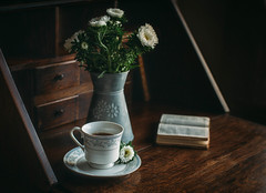 Afternoon tea at home (V Photography and Art) Tags: tea cupoftea desk antique books flowers light window living reading home