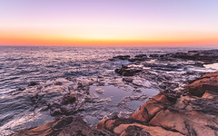 Rocky Sunrise Seascape (Merrillie) Tags: horizon color nature bay surf beauty background newsouthwales sea nsw beach ocean coastal wave outdoors avoca view dream landscape australia centralcoast water sunrise vacation weather rockshelf rocks waterscape longexposure scene coastline holiday beautiful travel sky scenic rocky dawn seascape clouds coast light avocabeach