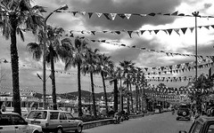 Bunting... (MickyFlick) Tags: muğlaprovince marmaris turkey bunting flags taxis boats palmtrees promenade
