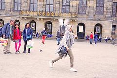 Amsterdam (kirstiecat) Tags: amsterdam pigeon bird strangers beauty movement flight woman architecture dutch netherlands