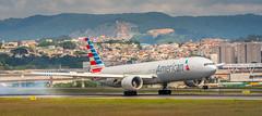 Touching down (Rodrigo Malutta) Tags: 777 rodrigo malutta rodrigomalutta d7100 gru american airlines touching down airplane aircraft nikon