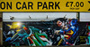 On Car Park £7.00 Per Day (Steve Taylor (Photography)) Tags: darkisseddayze margate batman superman 5 highstreet fighting punching batmanvssuperman art graffiti mural streetart carpark sign colourful uk gb england greatbritain unitedkingdom glow