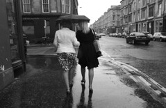 Tinsel Town In The Rain (Lord Eglinton) Tags: family daughter mother partick dancing couple tenement urban rain caledonia scotland ladies graduation university glasgow street dumbarton road pavement summer girl woman lady sundaylights people