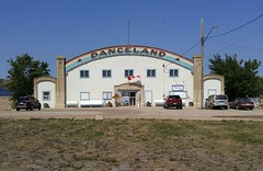 Saskatchewan Danceland 20170713_135142 (CanadaGood) Tags: canada saskatchewan sk watrous building ballroom parking tree sign prairie cameraphone 2017 thisdecade canadagood colour color green blue white red text