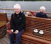 Hot chocolate on Windermere (Snapshooter46) Tags: holidaysnap cruising lakewindermere cumbria cruiseboat swan people woman sitting liferafts