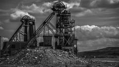 Double Head (devil=inside) Tags: handphotography sony a77 dereliction urbex former business coalmine pit head coal monochrome outdoors bw