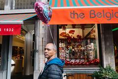 Brussels, Belgium (f.d. walker) Tags: bspf belgium brussels europe westerneurope man balloon heart helium ear face funny strange look streetphotography street candidphotography candid color colorphotography city