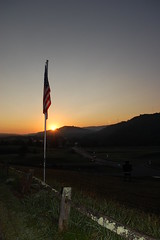 Sunrise At The Big Walker Motel. (dccradio) Tags: bland va virginia blandcounty sunrise mountain scenic nature landscape natural outdoors outside flag americanflag usflag unitedstatesflag usa flagpole nikon d40 dslr fence wood wooden woodenfence sun sunlight hill mountains hills morning goodmorning